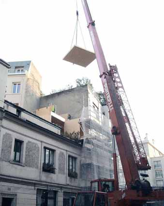 montage panneau bois surelevation-immeuble