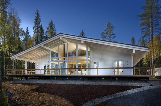 Maison bois avec bardage blanc