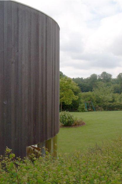 agrandissement en bois maison ancienne vue sur le jardin