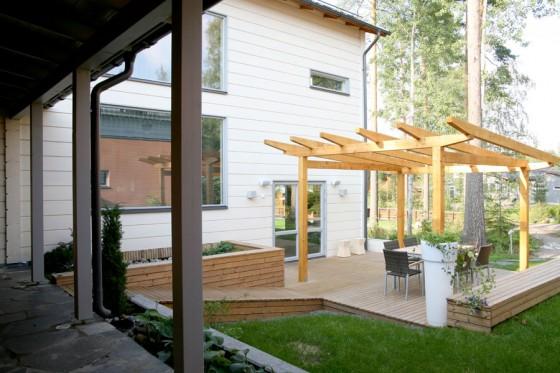 → Une maison en U avec patio – Maison contemporaine en bois massif