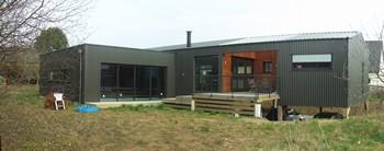 Extension maison pilotis cheap biotope habitat rfrences for Architecte 3d hauteur mur