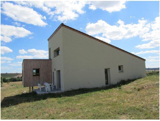 Construction d 39 une maison en bois et monomur for Maison brique monomur